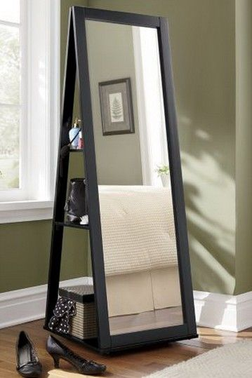 """Black Full Length mirror that has a 360 spin swivel feature. The backside has shelves for storage! 20"""" W x 20"""" D x 58"""" H - occasionally will go on sale for 153.00"""