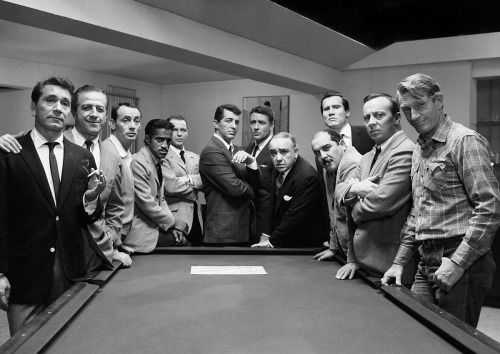 Richard Conte, Buddy Lester, Joey Bishop, Sammy Davis Jr., Frank Sinatra, Dean Martin, Peter Lawford, Akim Tamiroff, Richard Benedict, Henry Silva, Norman Fell and Clem Harvey production still from Lewis Milestone's Ocean's 11 (1960)