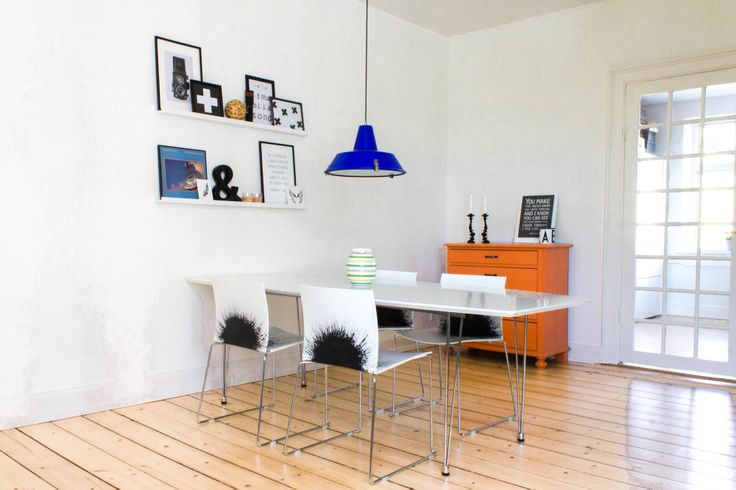 my DYI orange dresser and blue work lamp from Leitmotiv adds a splash of colour to our monochrome dining room.
