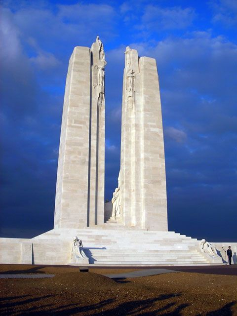 """We defy anyone not to be deeply affected by the Canadian National Vimy Memorial. The white, twin-columned monolith seemingly soaring to the clouds stands alone in open country slightly north of the 240-acre Canadian Memorial Park, of which it forms a part. The park is located at the top of Hill 145, fiercely fought for during the Battle of Arras."" Cross-Channel France; www.bradtguides.com"