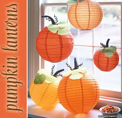 Simple orange paper lanterns are transformed into hanging pumpkins, perfectly suited for any Halloween or Fall party!