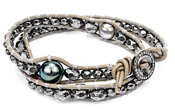 Iridescent, beautiful large Tahitian pearl and pure 100% silver double-wrap diamond button bracelet. This amazing bracelet features pure oxidized silver beads on putty color leather and wraps around the wrist twice. Statement making on it's own or to stack with your favorites. Definitely one-of-a-kind.