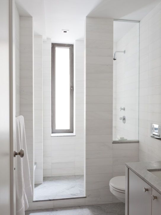 Small Marble Bathroom with fantastic bespoke shower screen and grey/white contrasts.