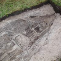 An early Viking age boat burial from Hillesøy outside the town of Tromsø. A man was interred in a sewn boat along with his dog, a heavy spear, a one edged sword and other burial goods. The inclusion of a bear pelt in the tomb might suggest the man was involved in hunting. (Article in Norwegian)