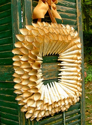 rolled paper wreath... maybe circular? maybe with old sheet music instead of paperbacks?