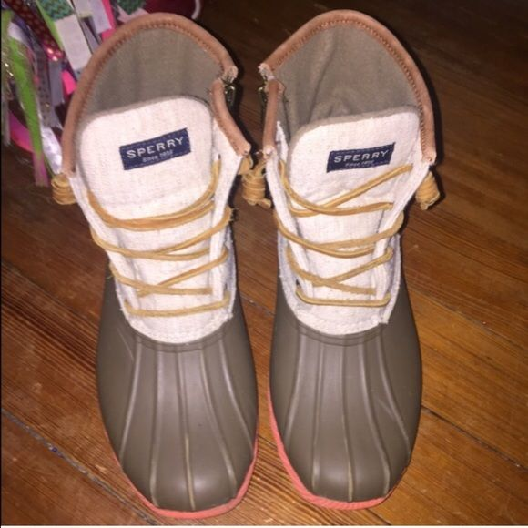 Sperry duck boots Women's beige sperry boots been worn maybe 2-3 times not even.  Wet weather-ready boots with rawhide lacing and a secure fit Canvas and rubber upper Round toe Microfleece lining Rubber sole Lightly padded insole Imported Sperry Top-Sider Shoes