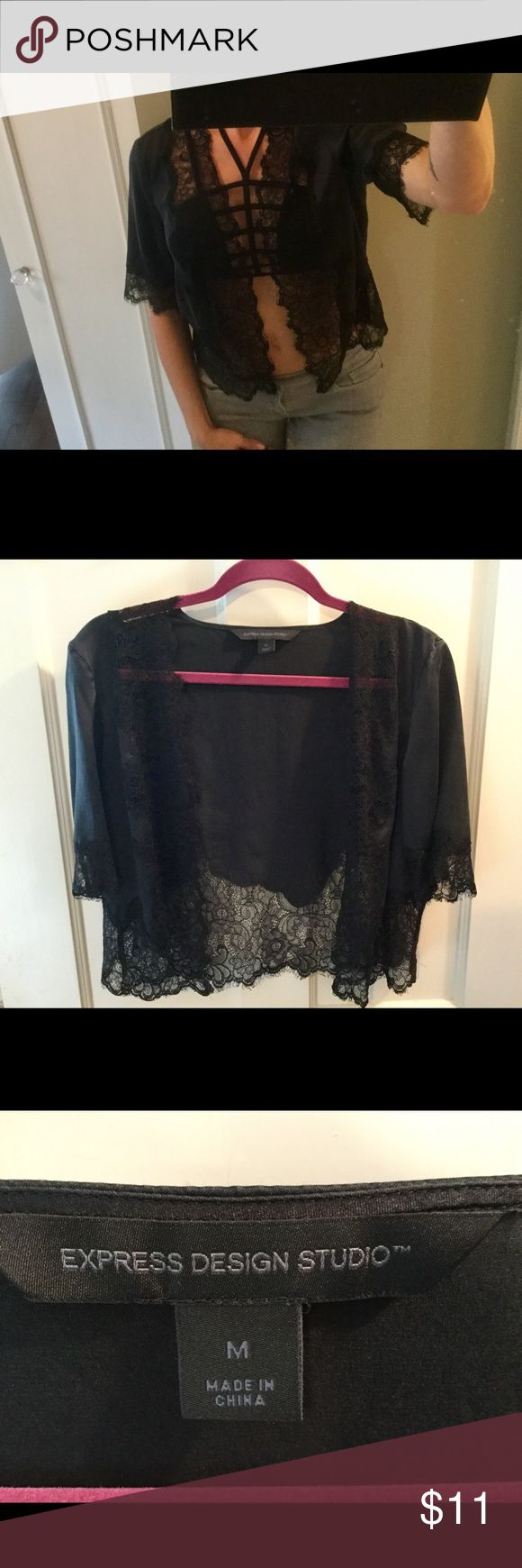 Express satin & lingerie top Express top, size Medium, button free, hangs open. Wear the look of lingerie with a cute pair of jeans and boots!  Pairs well with the leopard crossbody purse I'm selling. I love to mix romantic with edgy. PRICE has been dropped so PRICE is firm unless bundled. Thanks. Have fun 💋 Express Tops Blouses