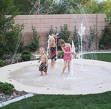 DIY Splash Pad! Love this cause you don't have to worry about drowning risks with the kids but they can still have a blast!!