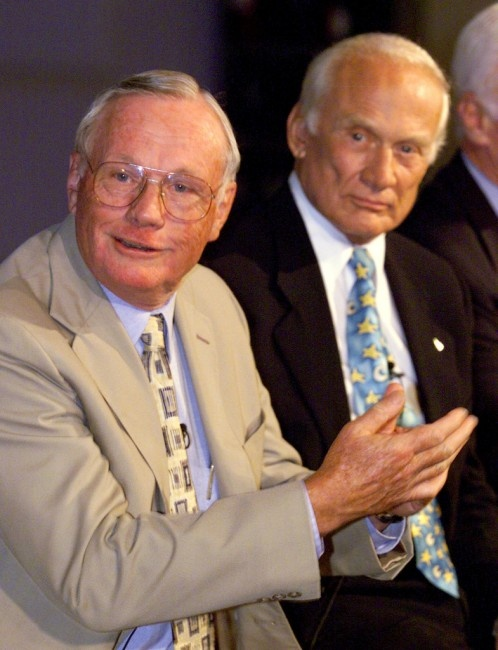 Apollo 11 astronauts Neil Armstrong (left) and Buzz Aldrin talk about the launch of Apollo 11 on the 30th anniversary of the event in 1999