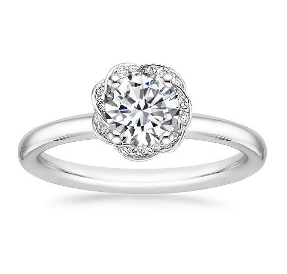 ''Asiago'' Twisted Halo Diamond Engagement Ring Mesmerizing ribbons of metal and pavé diamonds twist around the center diamond of this unique halo ring. Mounting type: Contemporary Four-Prong  Band Width: 2.0mm Extra Small Diamonds: 20-22 Average 0.20 total carat weight.