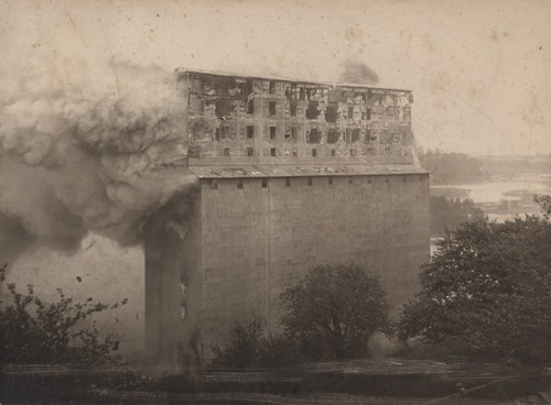 Multi-storey frame elevator built by Goderich Elevator & Transit Company shown being destroyed by fire. 1905, Goderich Ontario.