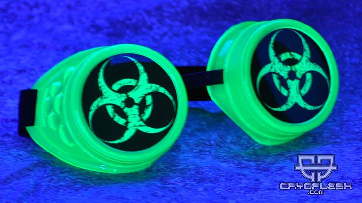 Cryoflesh.com  UV Reactive Green Plastic Goggles with symbols and a Adjustable Elstic Strap with Metal Tips.