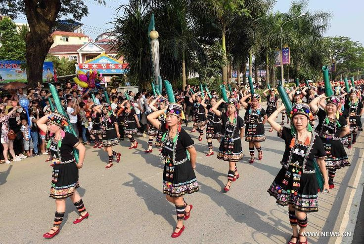 Women of Hani ethnic group perform during a cultural demonstration to celebrate the New Year of Dai ethnic group in Jinghong City, Dai Autonomous Prefecture of Xishuangbanna, Yunnan Province, April 14, 2015. Over 5,000 local people took part in the demonstration, presenting traditional arts and dances http://www.chinatraveltourismnews.com/2015/04/new-year-of-dai-ethnic-group-celebrated.html