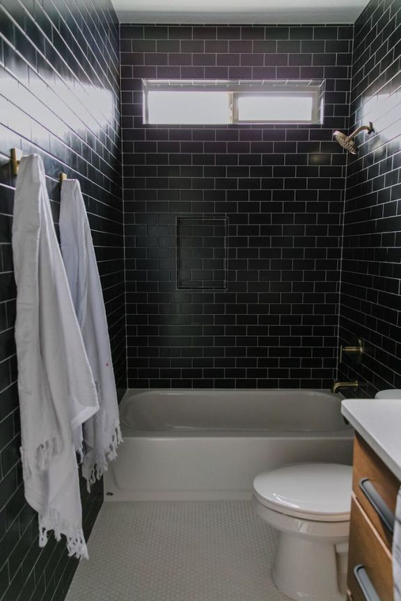 Becki Owens Project Reveal Modern Black Tile Bathroom Black Tile Bathrooms Black Bathroom Black Bathroom Accessories