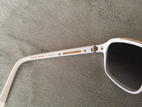 Louis Vuitton Evidence Sunglasses white frames w/gold accents