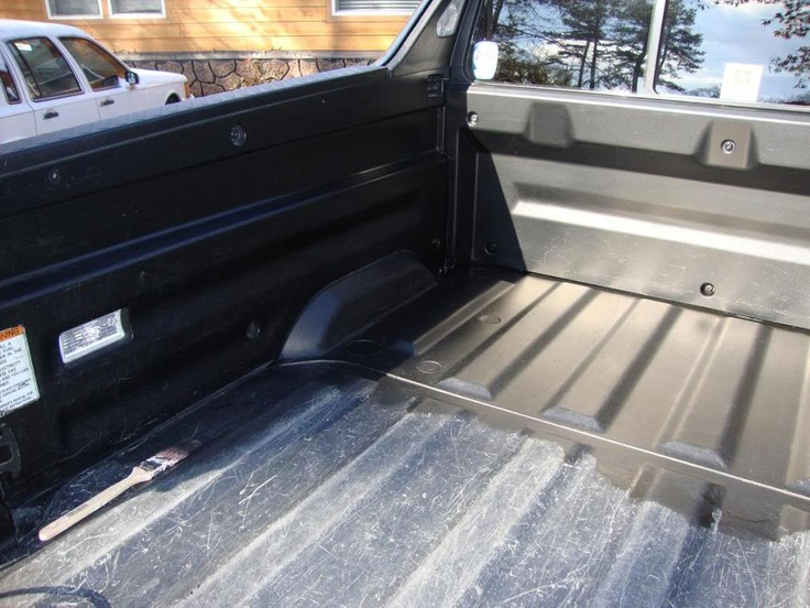 Use Bondo Restore Black to remove scratches from truck bed liner for only $10.