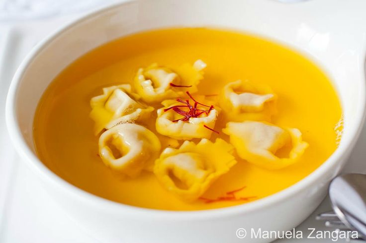 How to make saffron consommé out of home-made chicken stock and a recipe for tortellini, a typical Italian pasta filled with pork, mortadella, prosciutto and Parmigiano Reggiano.