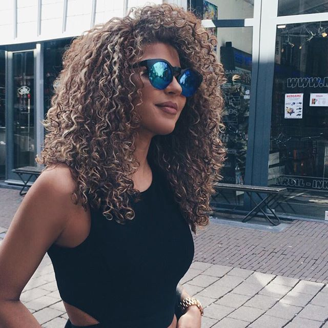 Relaxed Brown Curly Hair w. Blonde Highlights.                                                                                                                                                                                 More