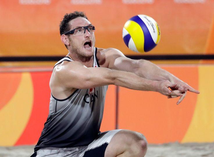 Canada's Josh Binstock digs against Austria during a men's beach volleyball match at the 2016 Summer Olympics in Rio de Janeiro, Brazil, Thursday, Aug. 11, 2016. (AP Photo/Marcio Jose Sanchez)