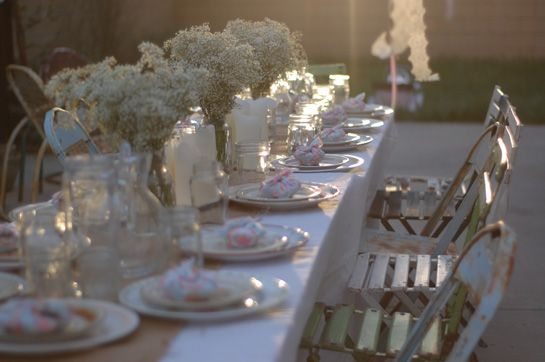 Beautiful dinner party. Baby's breath in simple vases/mason jars, candles and a burlap runner. I could do this!
