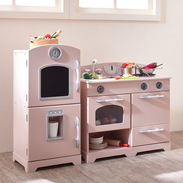 Get your little chef in training the gift of a lifetime with the Teamson Kids White and Pink Play Kitchen. Classy white with a splash of vibrant red, this play kitchen is designed to give your children the ultimate pretend play experience! A kitchen can be connected or detached to serve as two separate pieces. The kitchen's durable design and moving parts will keep your child entertained. Your little chef will love cooking in the Pink Modern Kitchen. Kids can pretend using the refrigerato...