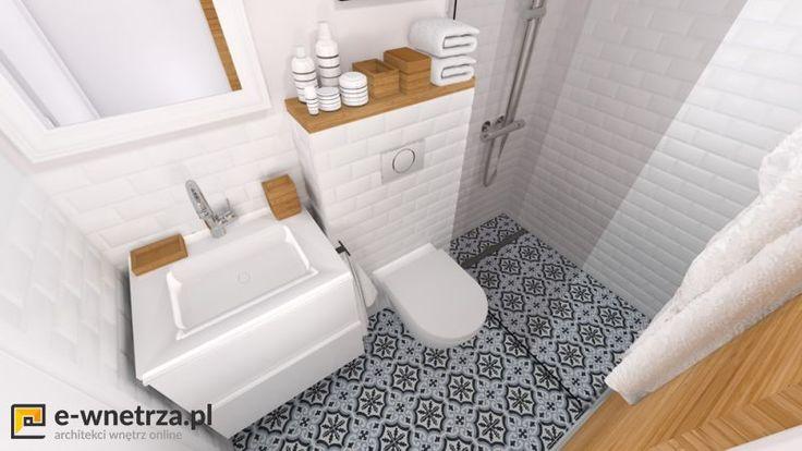 Marokanska mini łazienka 2 :) Biel przełamana jest  dodatkami z drewna oraz wzorzystą podłogą w stylu marokańskim. Pomieszczenie jest niezwykle małe, dlatego dodaliśmy jasne kolory oraz niewielkie wymiary kafli ściennych i podłogowych. Drzwi do kabiny zastanawialiśmy przesuwne, gdyż inne były by uciążliwe w użytkowaniu (ze względu na WC)