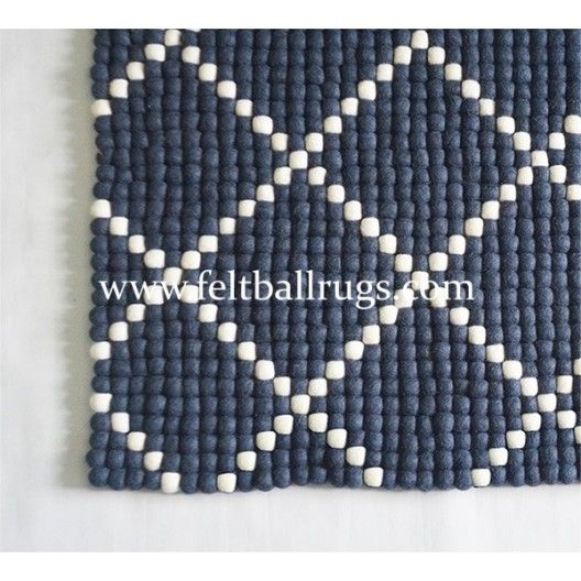 Dot Pattern Rectangle Felt Ball Rug handmade in Nepal. The rug measures 120x160cm and is available other custom sizes too. Colors are completely customizable.