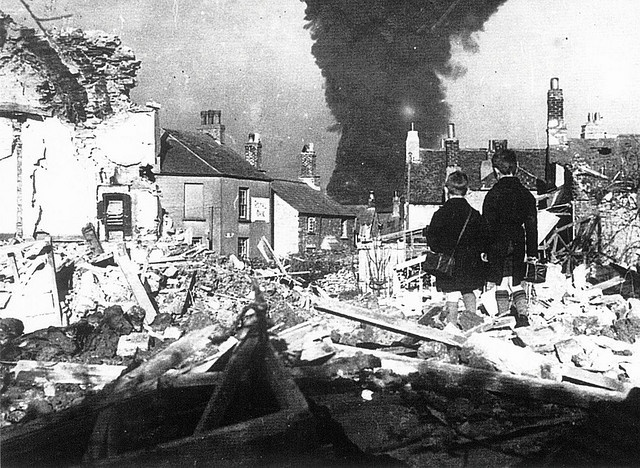 Two boys looking at the bomb damage at Turnchapel, Plymouth 1941
