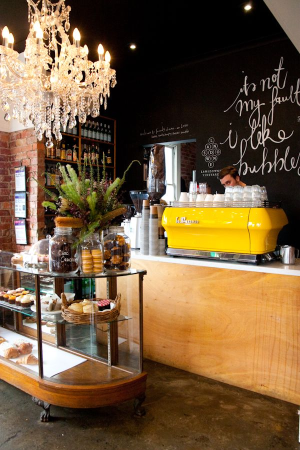 Ok I realize this is a coffee shop or something...but im liking this general idea (yellow, black, chandelier, chalkboard walls & quotes, oh and maybe the hot guy behind the counter can come too ^_^) for office space