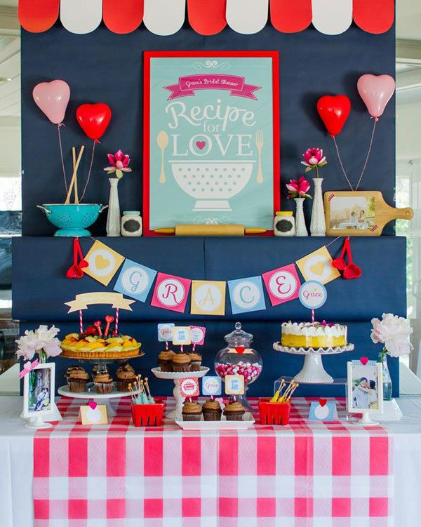 Kitchen themed retro bridal shower with bright pink gingham.