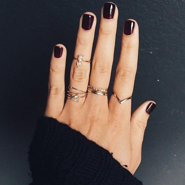 Dark mani and dainty rings