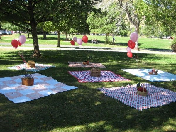 Picnic baskets and colorful blankets laden with sandwiches and treats for everyone