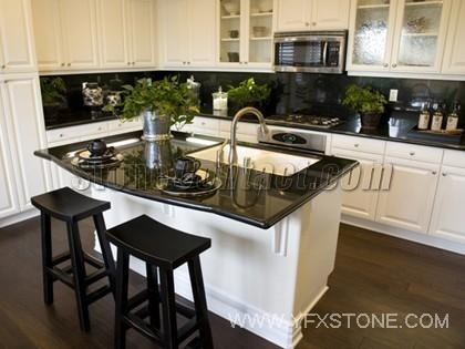Painting cupboards white/cream opens up a kitchen with black counters