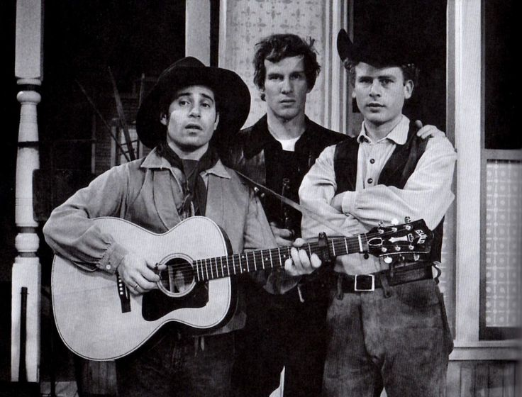 """oldfriendsandbookends: """" fickle-finger-of-fate: """" Paul Simon and Art Garfunkel, as Western Trobadours, with Tom Smothers, as Billy the Kid, in a first-season sketch on The Smothers Brothers Comedy..."""