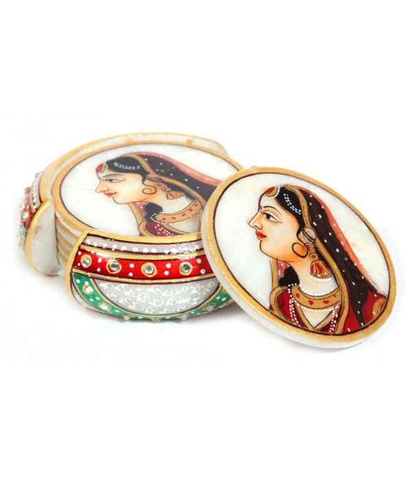 Tea Coaster is made with high grade marble, these Marble coaster set make an impressive gift or exquisite decorative accessory for the home.This marble coaster is adorned with the design of hand-painted Kishangarh Bani Thani. - See more at: http://potofgoodies.com/Marble-Artefacts?product_id=640