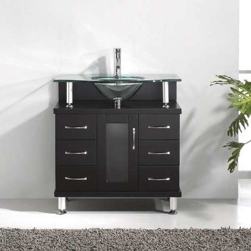 The Vincente vanity establishes a strong and solid foundation for any modern bathroom. The vanity features solid oak wood construction with one soft closing door and six storage drawers. The vanity is finished in a modern and crowned with a safety clear tempered glass basin-countertop. The Vincente set will make a great centerpiece to any bathroom design. Virtu USA has taken the initiative by changing the vanity industry and adding soft closing doors and drawers to their entire product line…