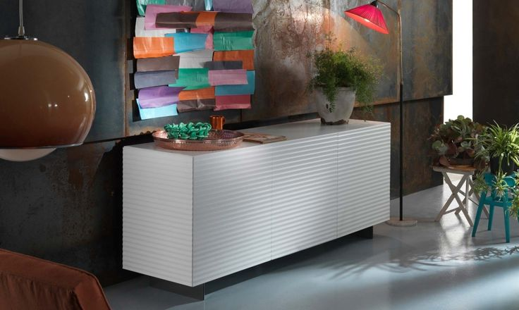 Ola sideboard by RIFLESSI  Stylish and trendy, this contemporary sideboard from our Ola range has a wooden frame with grooved front and sides. The Ola has one interior compartment with no dividers. Outstanding craftsmanship ensures a sleek appearance and superior functionality.  The Ola sideboard is available in three different sizes and various colors and finishes.  http://www.format-store.com/en/prod/living-area/sideboard-and-container/ola-sideboard-by-riflessi.html