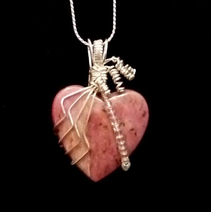 Custom made, wire wrapped, heart-shaped, Rhodonite cabochon. Hand crafted by Kathy Stewart - Glam N Glitter Eclectic Jewelry.