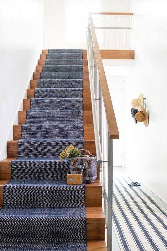 Herringbone blue runner on stairs and then blue & white runner in hallway