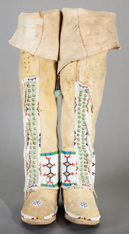 A PAIR OF CHEYENNE WOMAN'S BEADED HIDE BOOT MOCCASINS. c. 1910... | Lot #54111 | Heritage Auctions
