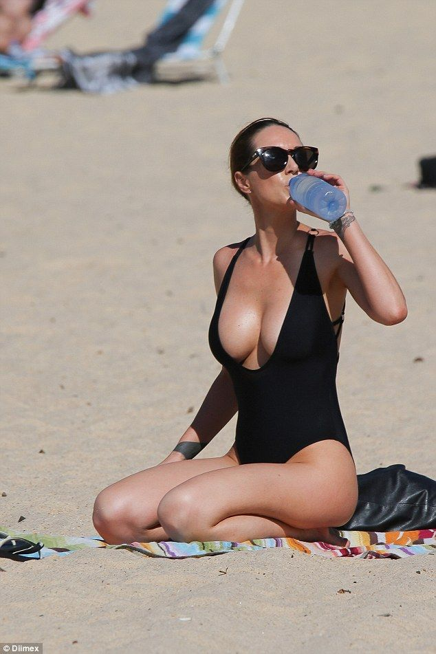 The Sydney-based DJ and lads' mag model completed her racy beach-side ensemble with a silv...