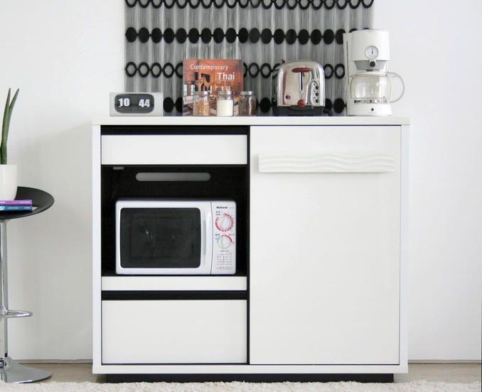 白のモダンなキッチン収納:斜め