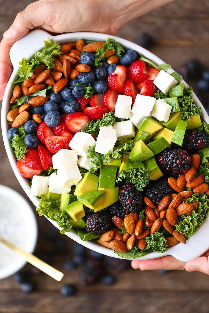 A colorful, hearty salad with the creamy poppy seed dressing, loaded with berries, feta, avocado and almond!