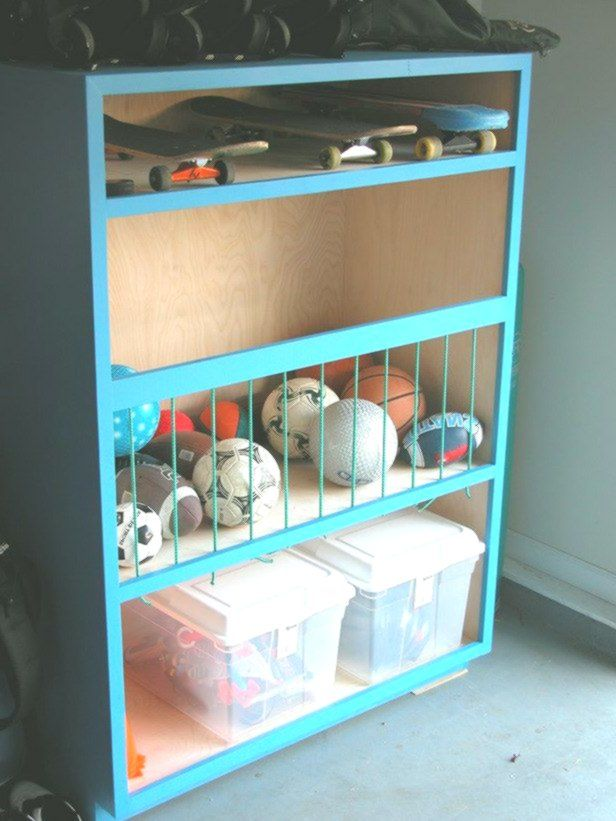 Game On Create A Sports Storage Center In The Garage To Keep All Sports Balls With Images Diy Toy Storage Outdoor Toy Storage Toy Storage Organization