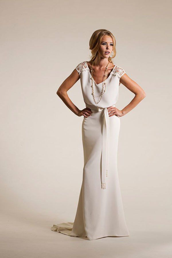 off-white sheath wedding dress with blouson top and lace cutouts at shoulder @myweddingdotcom
