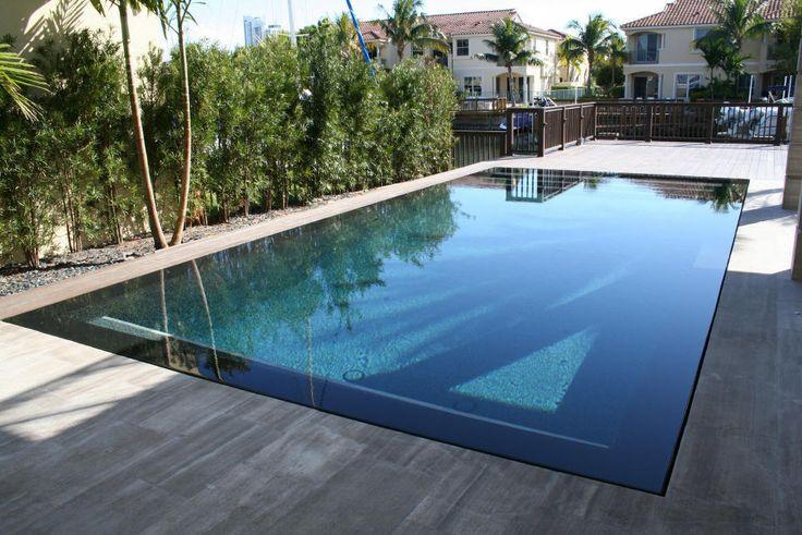 detail of spill over pool edge | hollywood overflow pool plantation lap pool w badu jet ft