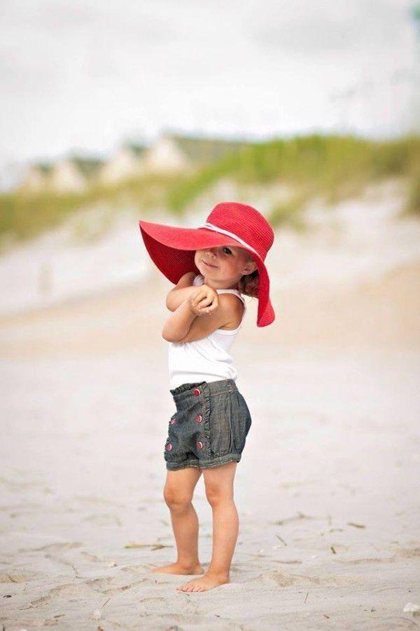 A cute little girl at the beach :)