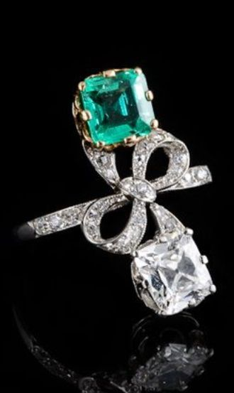 A Belle Epopque gold, platinum, diamond and emerald ring, French, about 1910.