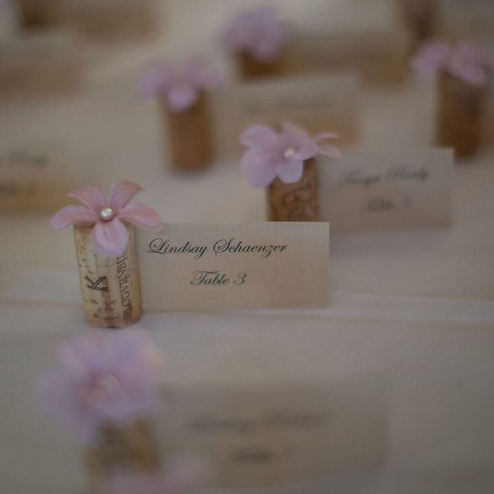 wedding favors ideas do it yourself%0A Simple place card holder idea from David Tutera  wine corks with a flower  and a