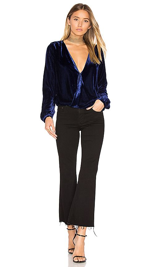 Shop for L'Academie The Surplice Blouse in Navy at REVOLVE. Free 2-3 day shipping and returns, 30 day price match guarantee.